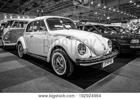 MAASTRICHT NETHERLANDS - JANUARY 14 2016: Subcompact Volkswagen Beetle. Black and white. International Exhibition InterClassics & Topmobiel 2016
