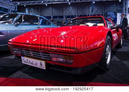 MAASTRICHT NETHERLANDS - JANUARY 14 2016: Sports car Ferrari 328 GTS (Gran Turismo Spider) 1989. International Exhibition InterClassics & Topmobiel 2016