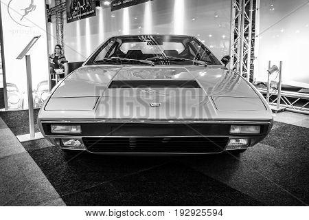 MAASTRICHT NETHERLANDS - JANUARY 14 2016: Sports car Ferrari Dino 308 GT 4 1974. Black and white. International Exhibition InterClassics & Topmobiel 2016