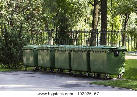 Plastic containers for garbage in the green park