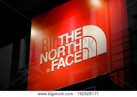 Bologna Italy 1 May 2017 - the North Face logo on the store front sign in Bologna