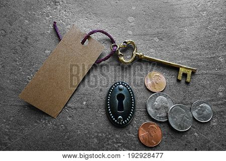 Blank tag with gold key keyhole and coins