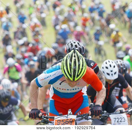 STOCKHOLM SWEDEN - JUNE 11 2017: Closeup of elite mountain bike cyclist competitors behind at Lida Loop Mountain bike Race. June 11 2017 in Stockholm Sweden