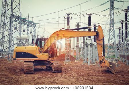excavator crawler at construction site of electrical substation of industrial sector. concept of industrial construction.