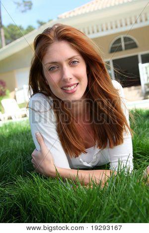Beautiful woman laying down home garden