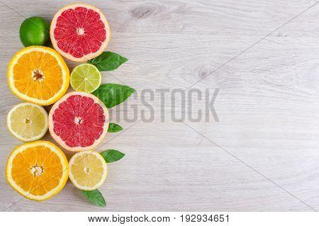 Juicy Citrus Fruits Cut Background Mint Leaf. Oranges, Lemons, Limes, Grapefruit, Mint Leaves On A B