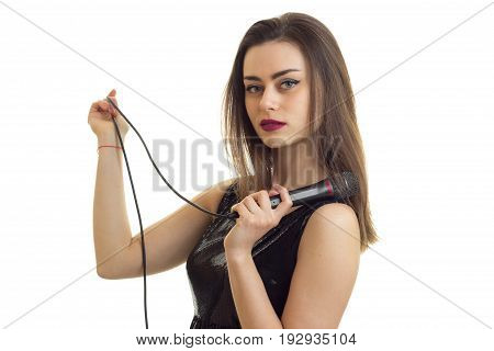 sexy young girl holding a microphone from karaoke isolated on a white background close-up