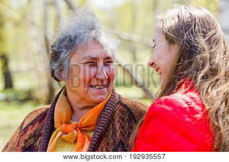 Photo of happy elderly woman with her daughter having fun