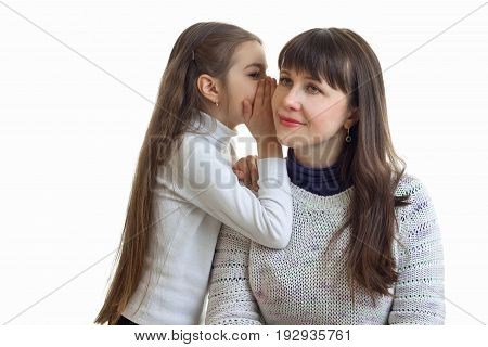 Portrait of a young mother and daughter who sets the secrets on the eyelet is isolated on a white background close-up