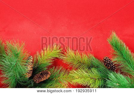 Christmas green framework on red fabric background