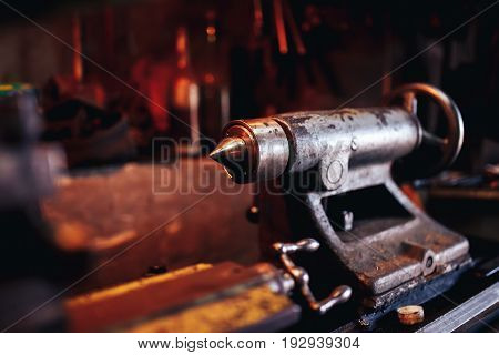 Lathe for production of parts. Concept industrial production in the garage, business.