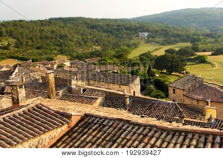 Miniature effect of small provence village on hill in countryside -Roofs in golden sunset - Family trip to France