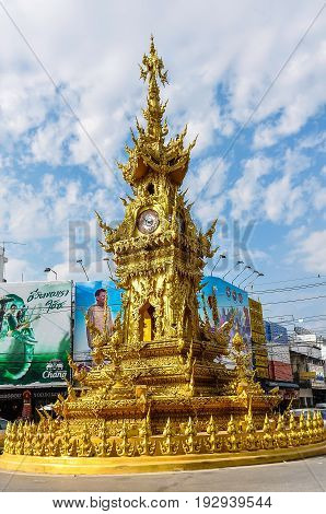 CHIANG RAI, THAILAND - DECEMBER 24, 2012: Golden Clock Tower in the city of Chiang Rai Thailand