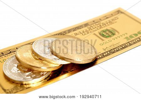 Golden end silver bitcoins with U.S. dollar isolated on white