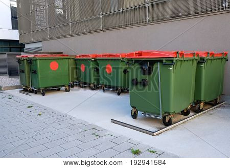 Green recycling or garbage bins outdoors. Recycling.