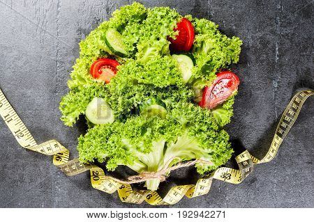 A Tree Or Bouquet Of Lettuce With Cucumber And Tomato Centimeter Tape Around. Diet Concept.