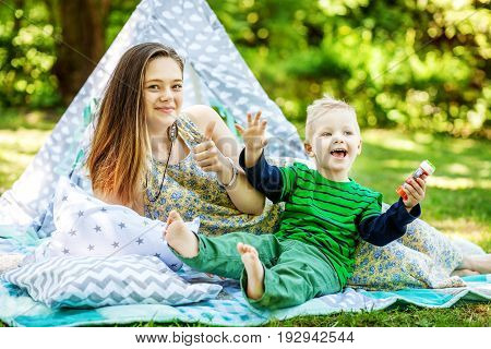 Happy mother and little son playing in the park. The concept of lifestyle and childhood.