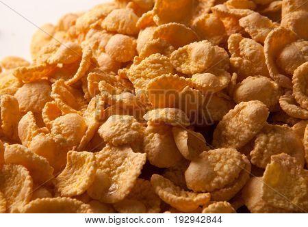 Pile of yellow caramel cornflakes close up