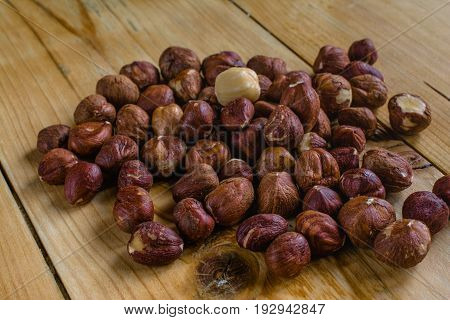 Tasty small brown nuts on wood table