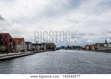 Copenhagen Denmark - August 12 2016: Waterfront of Copenhagen a cloudy summer day