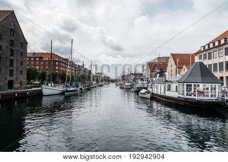 Copenhagen Denmark - August 12 2016: Port of Copenhagen with old ships a cloudy summer day