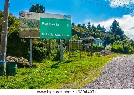 QUITO, ECUADOR - MAY 07, 2014: Informative sign in Papallacta, in a beautiful landscape in a sunny day with the road in Quito Ecuador.