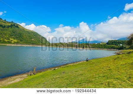 Beautiful lagoon located in Papallacta the Andean highlands in a sunny day in Quito Ecuador.