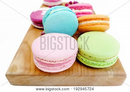Gourmet Macaron Colorful Cookies On Wood Desk. Isolated On White Background