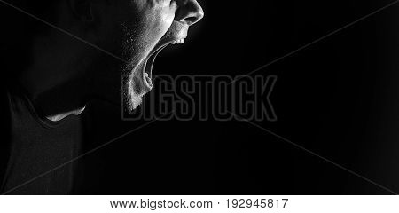 screaming angry aggressive militant guy man black and white portrait evil face teeth