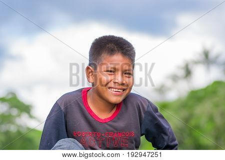 LAGO AGRIO, ECUADOR - NOVEMBER 17, 2016: Portrait Of Young Indigenous boy, of Siona community inside of Cuyabeno National Park, South America in Ecuador.