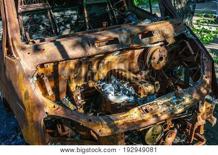 Burnt after fire rusty abandoned car minibus