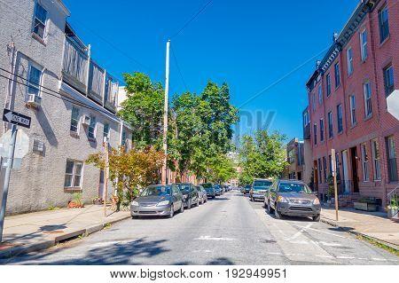 PHILADELPHIA, USA - NOVEMBER 22, 2016: Beautiful view of buildings at Washington Square, with some cars parked in Philadelphia, Pennsylvania.