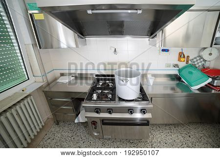 Kitchen With Big Cauldron Of Aluminium And The Cookers Of Steel