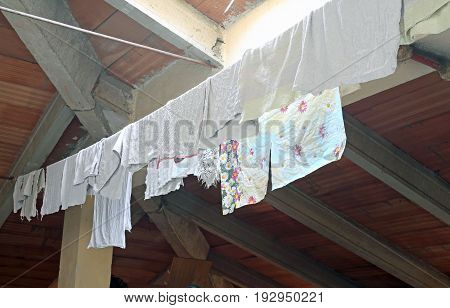 Rags And Canvas Hung To Dry In The Attic Of The House