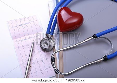 Closeup Folder file, stethoscope on a rx prescription, red heart and phone isolated on white background