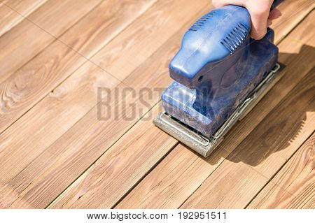 Blue grinder on wooden floor, photo above