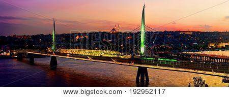 Metro station on Golden Horn bridge in Istanbul at dusk, Turkey
