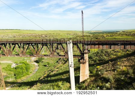 Old metal bridge with a railway over the river