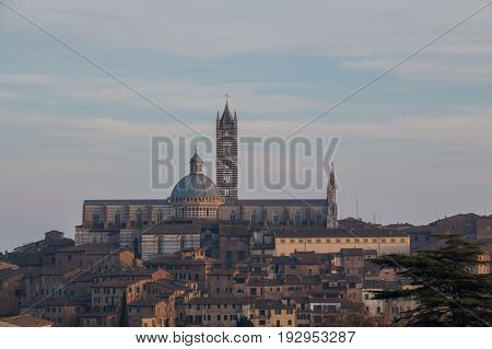 Italy Siena - December 26 2016: the view of Duomo di Siena or Metropolitan Cathedral of Santa Maria Assunta from north on December 26 2016 in Siena Tuscany Italy.