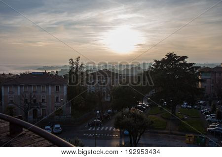 Italy Siena - December 26 2016: the view of typical building in Siena green park and parking at sunset light on December 26 2016 in Siena Tuscany Italy.