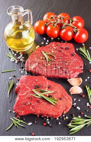 Raw steak with, spices and ingredients for cooking.