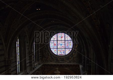 Italy Siena - December 26 2016: interior view of Metropolitan Cathedral of Santa Maria Assunta. Duccio di buoninsegna is stained glass window of the Duomo di Siena on December 26 2016 in Siena Tuscany Italy.
