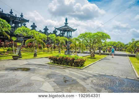 BALI, INDONESIA - MARCH 08, 2017: Panoramic landscape traditional balinese hindu temple Bajra Sandhi in Denpasar, Bali, Indonesia on background tropical nature and blue summer sky, Indonesia.