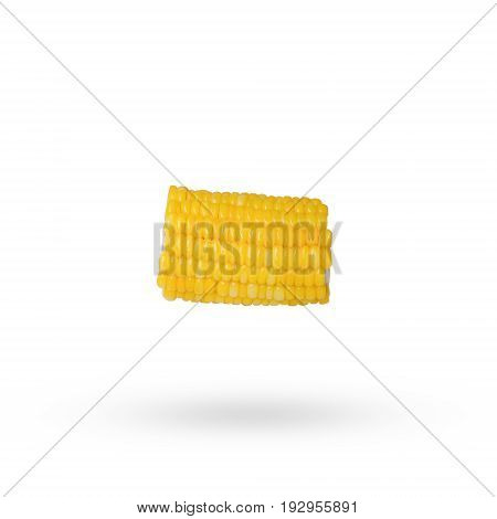 a sliced piece of yellow corn isolated on white