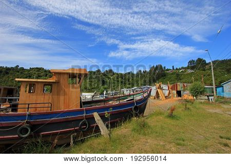 Building wooden boats by hand from tree trunks, Chiloe Island, Chile, South America