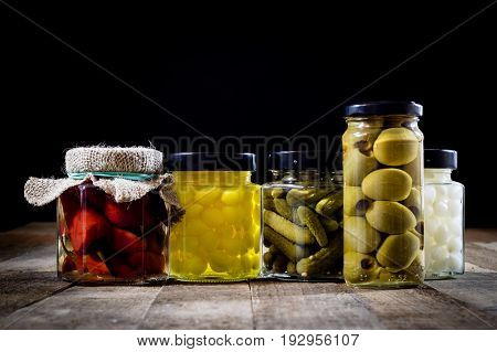 Mortar, Vegetables In Jars For The Winter, Wooden Table In The Old Kitchen