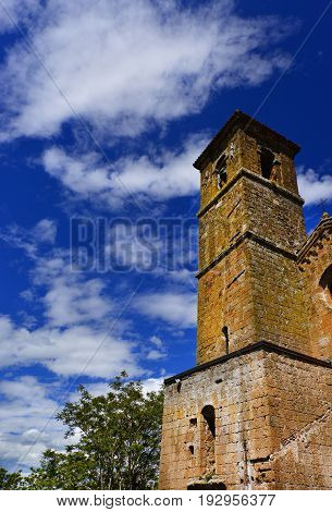 Medieval Chiesa di San Giovenale belfry with clouds one of the most ancient churches in the historic center of Orvieto in Umbria Italy