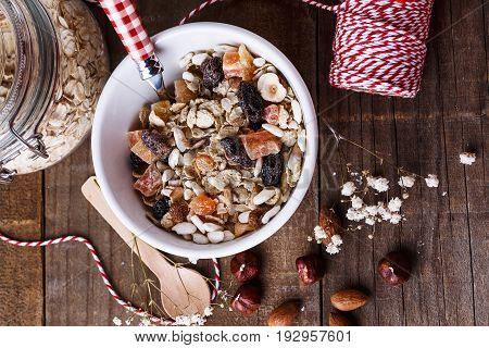 Healthy gluten free muesli with nuts and dried berry over rustic wooden background from above. Clean eating Healthy living Vegan Vegetarian Gluten free food concept