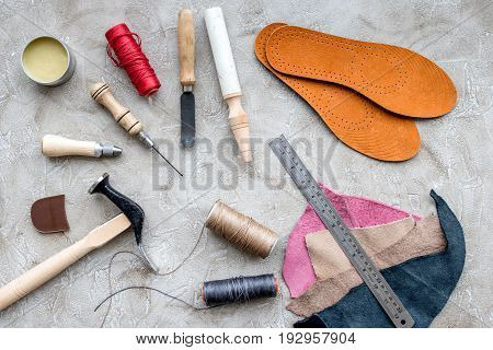 Clobber preparing his tools for work. Grey stone desk background top view.