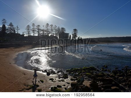 Panoramic view of Dee Why beach (Sydney NSW Australia) on a sunny day. A great place to relax as the beach is mainly frequented by locals.